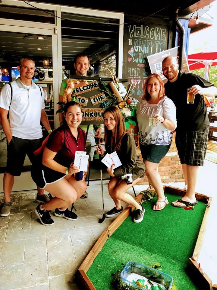 Patrons Playing Putt Putt Golf